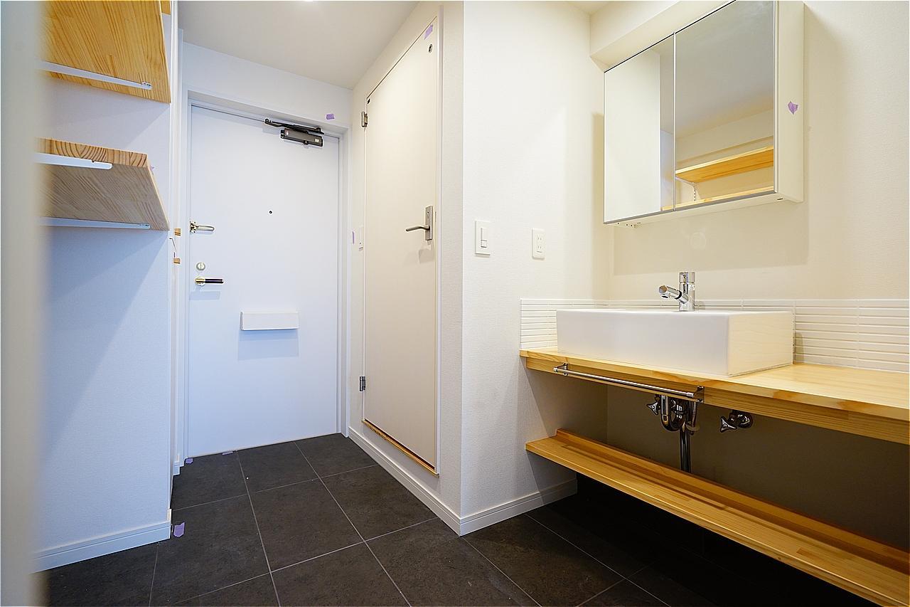 廊下に洗面台を設置したお部屋